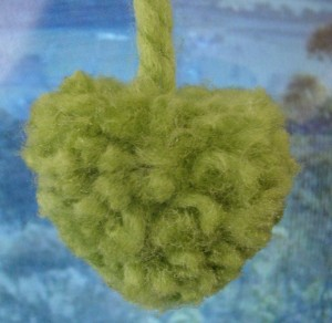For more advanced shaping, cut your pom-pom into a heart - I sprayed with glitter glue to set the shape-great practice for giving a haircut to a poodle ! :) kx